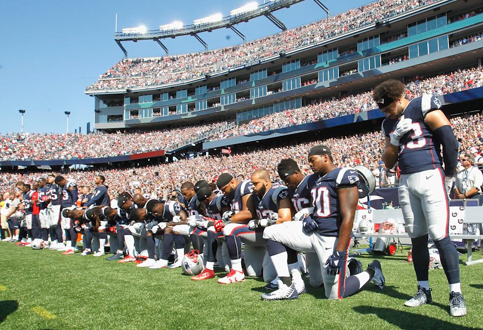 Members of the New England Patriots kneel during the National Anthem before a game against the Houston Texans at Gillette Stadium on September 24, 2017 in Foxboro, Massachusetts. (Photo by Jim Rogash/Getty Images)