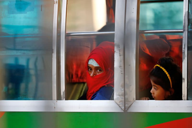 Rohingyas that will be shifted to Bhasan Char island are seen onboard a bus in Chattogram