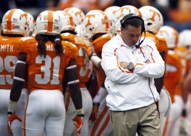 Tennessee coach Butch Jones walks away from the huddle during a timeout in the fourth quarter of an NCAA college football game against Auburn on Saturday, Nov. 9, 2013 in Knoxville, Tenn. Auburn won 55-23. (AP Photo/Wade Payne)
