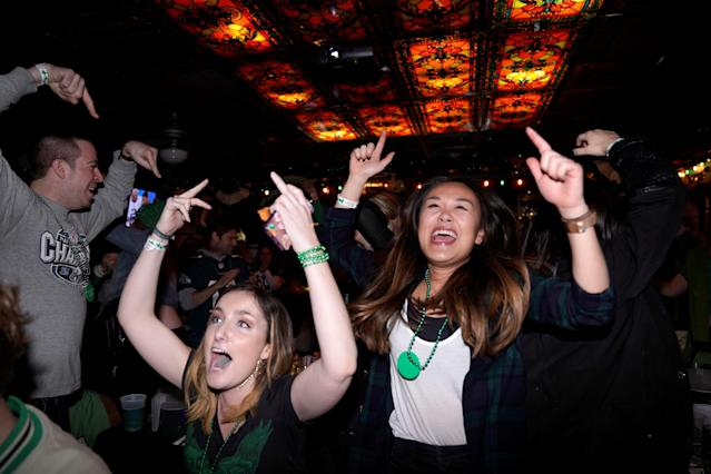 Football fans react as they watch Super Bowl LII between the New England Patriots and the Philadelphia Eagles at the city's oldest tavern, McGillin's Olde Ale House in Philadelphia, Pennsylvania, February 4, 2018. REUTERS/Jessica Kourkounis