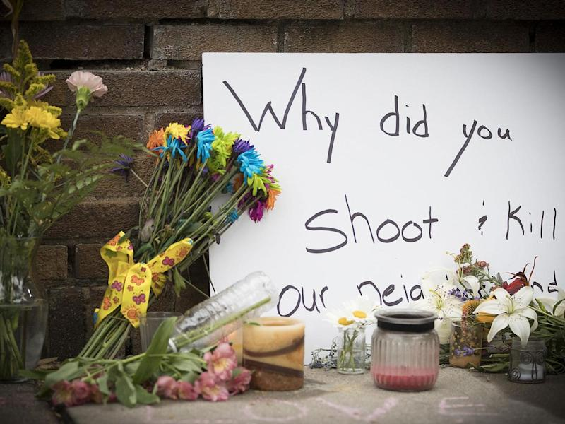 A makeshift memorial is left at the scene where a Minneapolis police officer shot and killed Justine Damond (Elizabeth Flores/Star Tribune via AP)