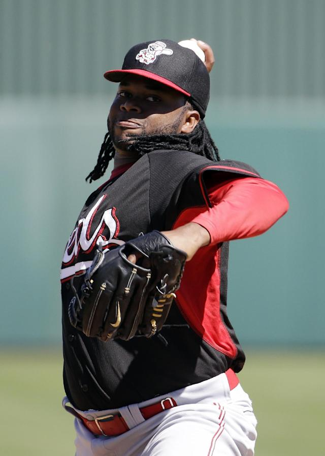 Cincinnati Reds' Johnny Cueto throws before the first inning of an exhibition spring training baseball game against the Los Angeles Angels Sunday, March 9, 2014, in Tempe, Ariz. (AP Photo/Morry Gash)