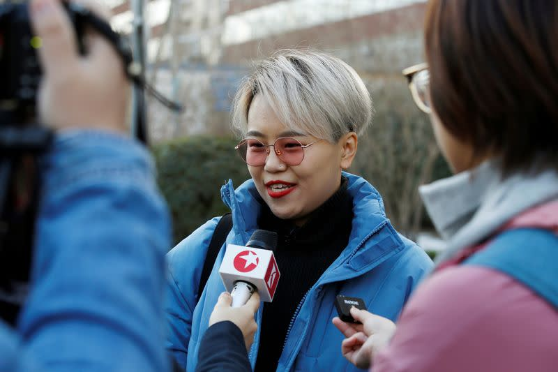 Teresa Xu talks to journalists outside Chaoyang People's Court before a court hearing of her suit against a Beijing hospital for rejecting her request to freeze her eggs on the grounds that she is unmarried, in Beijing
