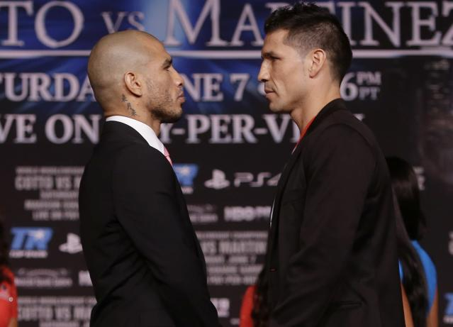 Boxers Sergio Martinez, of Argentina, right, and Miguel Cotto, of Puerto Rico, pose during a news conference for their upcoming fight Wednesday, June 4, 2014, in New York. Martinez and Cotto will fight on June 7 at Madison Square Garden in New York. (AP Photo/Frank Franklin II)