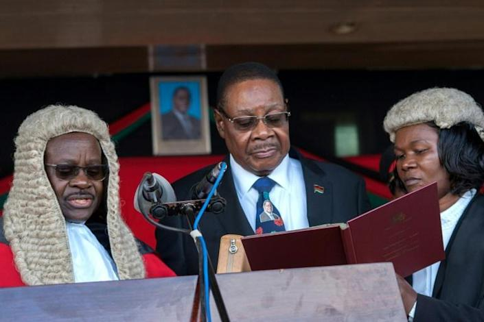 May 28 2019: Peter Mutharika, centre, is sworn in for his second term by Chief Justice Andrew Nyirenda, left. Months later, Nyirenda headed the the Supreme Court when it overturned the election result (AFP Photo/AMOS GUMULIRA)