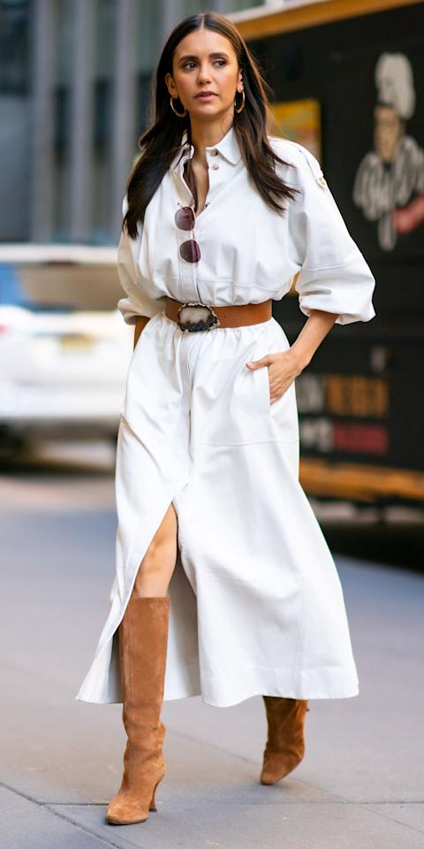 """<p>Arguably the biggest shoe trend of the past couple months has been tall boots, whether they be simple and <a href=""""https://www.instyle.com/fashion/amal-clooney-knee-high-boots-trend"""">black like Amal Clooney's</a> or <a href=""""https://www.instyle.com/fashion/shoes/nordstrom-sale-tall-snakeskin-boots"""">bold and snake-y like Jennifer Lopez's</a>. With spring just days away, you don't necessarily need to pack them all up though. While at <em>The Today Show</em> in New York, Nina Dobrev made the case for tall suede boots (<strong>Shop now: </strong>$550; <a href=""""https://click.linksynergy.com/deeplink?id=93xLBvPhAeE&mid=42352&murl=https%3A%2F%2Fwww.shopbop.com%2Fstevie-boots-by-far%2Fvp%2Fv%3D1%2F1536697525.htm%3F&u1=IS%2CLOTD-NinaDobrev-Slide%2Ckchiello1271%2C%2CIMA%2C3528371%2C202003%2CI"""" target=""""_blank"""">shopbop.com</a>) for spring by pairing hers with a Gabriella Hearst maxi dress (<strong>Shop now: </strong>$1,990; <a href=""""https://click.linksynergy.com/deeplink?id=93xLBvPhAeE&mid=25003&murl=https%3A%2F%2Fwww.neimanmarcus.com%2Fp%2Fgabriela-hearst-ares-button-front-midi-dress-prod229130081%3F&u1=IS%2CLOTD-NinaDobrev-Slide%2Ckchiello1271%2C%2CIMA%2C3528371%2C202003%2CI"""" target=""""_blank"""">neimanmarcus.com</a>). </p>"""