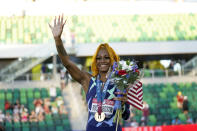 Sha'Carri Richardson waves after winning the women's 100-meter run at the U.S. Olympic Track and Field Trials Saturday, June 19, 2021, in Eugene, Ore. (AP Photo/Ashley Landis)