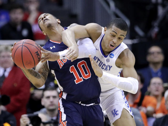 Auburn's Samir Doughty (10) and Kentucky's Keldon Johnson collide during the second half of the Midwest Regional final game in the NCAA men's college basketball tournament Sunday, March 31, 2019, in Kansas City, Mo. (AP Photo/Charlie Riedel)