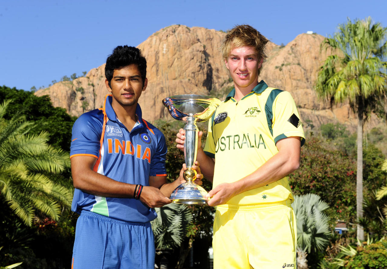 TOWNSVILLE, AUSTRALIA - AUGUST 25:  Unmukt Chand of India and William Bosisto of Australia pose with the U19 Cricket World Cup trophy ahead of the 2012 ICC U19 Cricket World Cup Final at Queens Gardens on August 25, 2012 in Townsville, Australia.  (Photo by Ian Hitchcock-ICC/Getty Images)