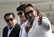 Members of the Mexican grupera band Los Bukis, from left, Pedro Sanchez, Roberto Guadarrama and Marco Antonio Solis attend a press conference at SoFi Stadium on Monday, June 14, 2021, in Inglewood, Calif. Twenty five years after their last show as a band, the group announced that they are reuniting for a U.S. tour. (AP Photo/Chris Pizzello)