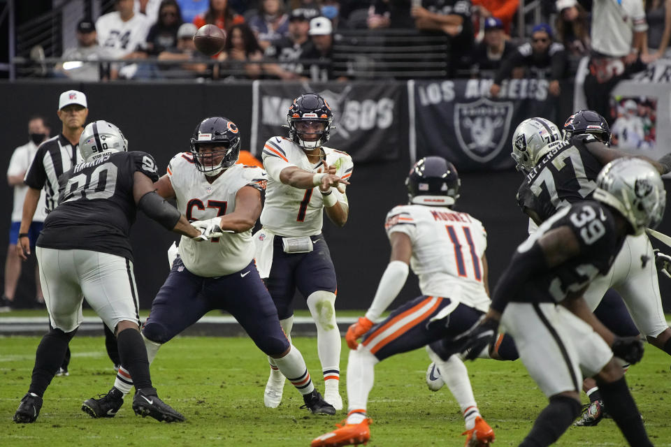 Chicago Bears quarterback Justin Fields (1) throws to wide receiver Darnell Mooney (11) during the second half of an NFL football game against the Las Vegas Raiders, Sunday, Oct. 10, 2021, in Las Vegas. (AP Photo/Rick Scuteri)