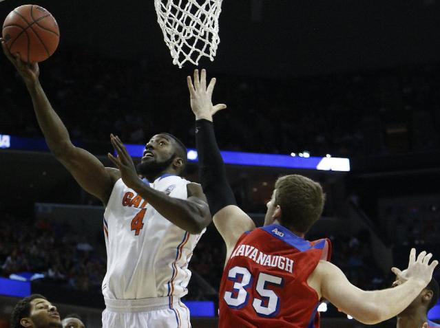 Florida center Patric Young (4) shoots against Dayton forward/center Matt Kavanaugh (35) during the first half in a regional final game at the NCAA college basketball tournament, Saturday, March 29, 2014, in Memphis, Tenn. (AP Photo/Mark Humphrey)