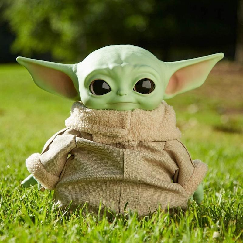 """His official title might be """"The Child"""" for now, but there are lots of us who call this little one Baby Yoda. And now you can <a href=""""https://amzn.to/2HlC1e4"""" target=""""_blank"""" rel=""""noopener noreferrer"""">get a plush version of him</a>thatcan either be """"perfect for cuddling"""" or a collectible that's held high on your shelves. It comes with the furry coat you see on the show.<a href=""""https://amzn.to/2HlC1e4"""" target=""""_blank"""" rel=""""noopener noreferrer"""">Find it for $19 at Amazon</a>. There's an <a href=""""https://amzn.to/3kANXXB"""" target=""""_blank"""" rel=""""noopener noreferrer"""">animatronic Baby Yoda toy</a>, too."""