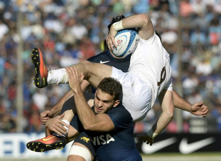 Georgia's scrum-half Vasil Lobzhanidze (R) is tackled by Argentina's Los Pumas wing Ramiro Moyano during their Rugby Union test match at 23 de Agosto stadium in San Salvador de Jujuy, Jujuy, Argentina on June 24, 2017
