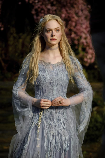 "This image released by Disney shows Elle Fanning as Aurora in a scene from ""Maleficent: Mistress of Evil."" (Jaap Buitendijk/Disney via AP)"