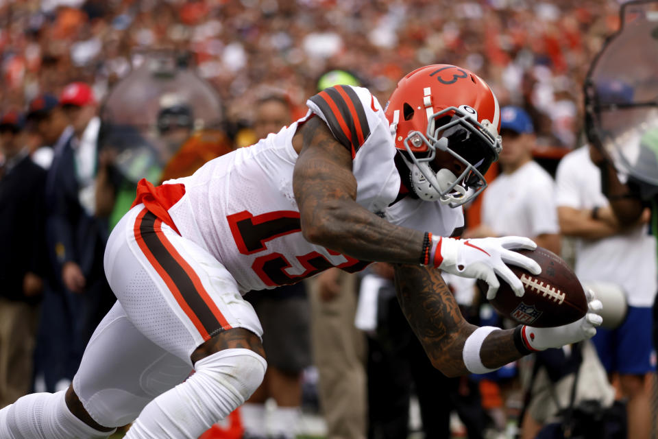 Cleveland Browns wide receiver Odell Beckham Jr. (13) dives in an attempt to make a catch during an NFL football game against the Chicago Bears, Sunday, Sept. 26, 2021, in Cleveland. (AP Photo/Kirk Irwin)