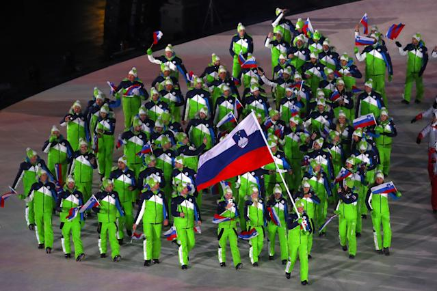 <p>Flag bearer Vesna Fabjan of Slovenia and teammates enter the stadium during the Opening Ceremony of the PyeongChang 2018 Winter Olympic Games at PyeongChang Olympic Stadium on February 9, 2018 in Pyeongchang-gun, South Korea. (Photo by Dean Mouhtaropoulos/Getty Images) </p>