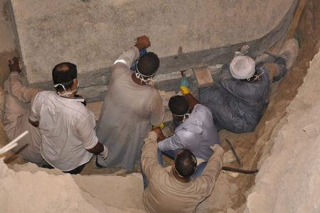 Egyptian excavation workers labor at outside the site of the newly discovered giant black sarcophagus in Sidi Gaber district of Alexandria, Egypt July 19, 2018 in this handout picture courtesy of the Ministry of Antiquities. The Ministry of Antiquities/Handout via Reuters