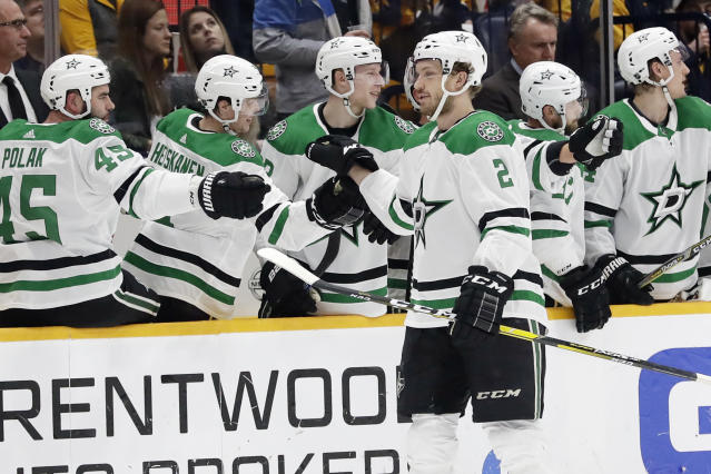 Dallas Stars defenseman Jamie Oleksiak (2) is congratulated after scoring a goal against the Nashville Predators in the second period of an NHL hockey game, Saturday, Dec. 14, 2019, in Nashville, Tenn. (AP Photo/Mark Humphrey)