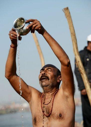 <p>A Hindu devotee prays on the banks of the River Ganges during the Kumbh Mela in Allahabad, on February 9, 2013. Tens of millions of Hindu pilgrims are preparing to cleanse their sins with a plunge into the sacred River Ganges, ahead of the most auspicious day of the world's largest religious festival.</p>