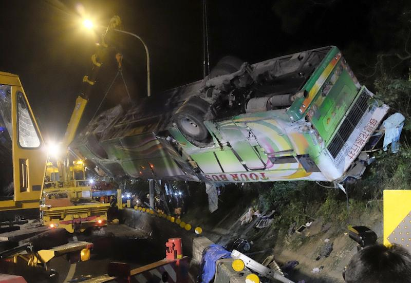 A group of tourists had been returning from a trip to see cherry blossoms at a farm in Taiwan in February when their bus veered off a highway on the outskirts of capital Taipei (AFP Photo/Sam YEH)