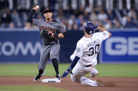 Apr 1, 2019; San Diego, CA, USA; Arizona Diamondbacks second baseman Wilmer Flores (left) forces out San Diego Padres first baseman Eric Hosmer (30) at second base before throwing to first base to complete the double play during the eighth inning at Petco Park. Mandatory Credit: Orlando Ramirez-USA TODAY Sports