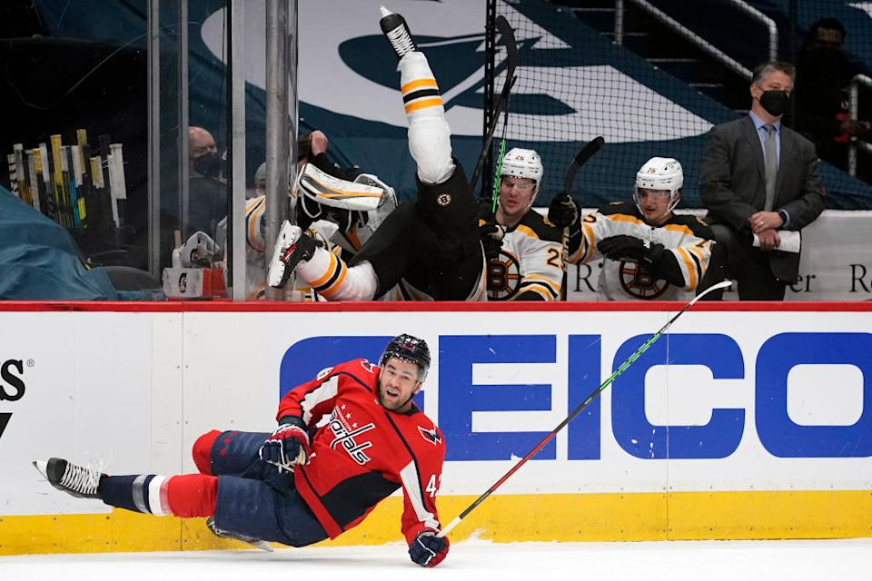 Tom Wilson sent Curtis Lazar flying into the Bruins bench with a monster hit in Game 2. (Getty Images)