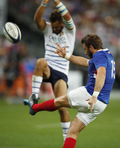 France's Maxime Medard kicks the ball during a friendly rugby test match between France and Italy at Stade de France in Saint Denis, north of Paris, France, Friday, Aug. 30, 2019. (AP Photo/Francois Mori)