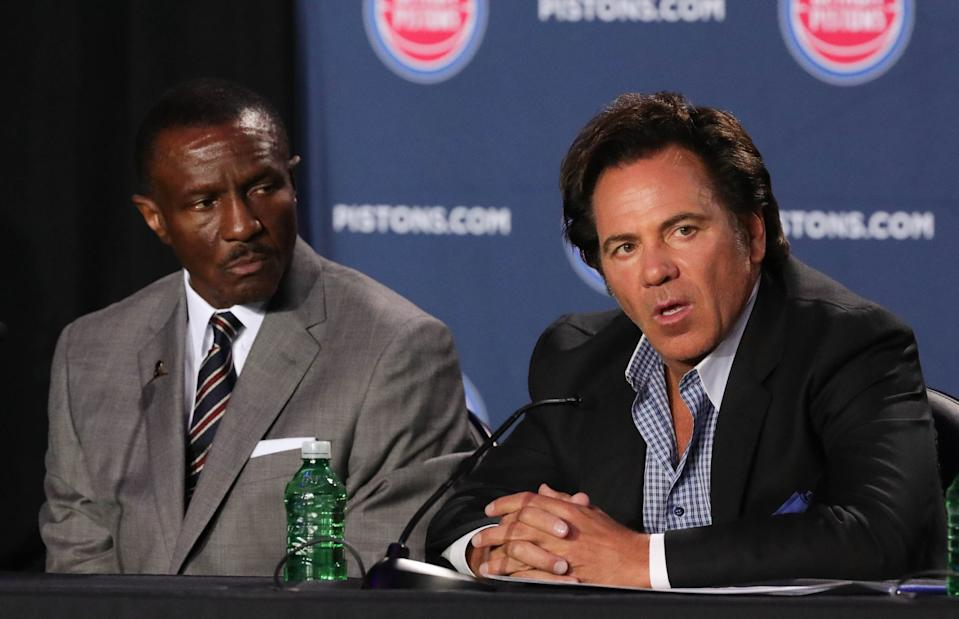 New Detroit Pistons head coach Dwane Casey listens as owner Tom Gores takes questions Wednesday, June 20, 2018, at Little Caesars Arena in Detroit.