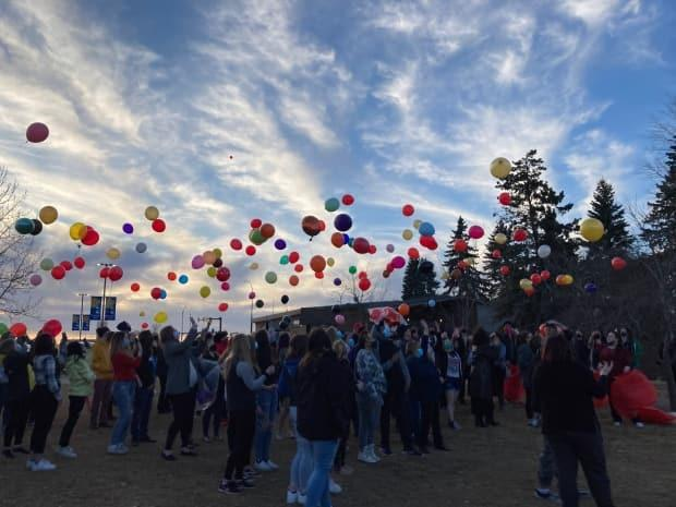 Balloons were released in Leduc Thursday evening to honour the life of 17-year-old Jenny Winkler. (Tricia Kindleman/CBC - image credit)