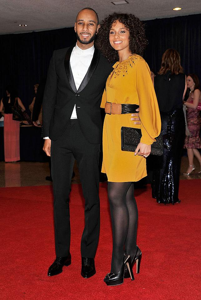 Grammy darling Alicia Keys rocked a retro look, which included a belted tunic, platform pumps, and a voluminous 'do, while her hubby/baby daddy, Swizz Beats, failed to impress in a collarless shirt.