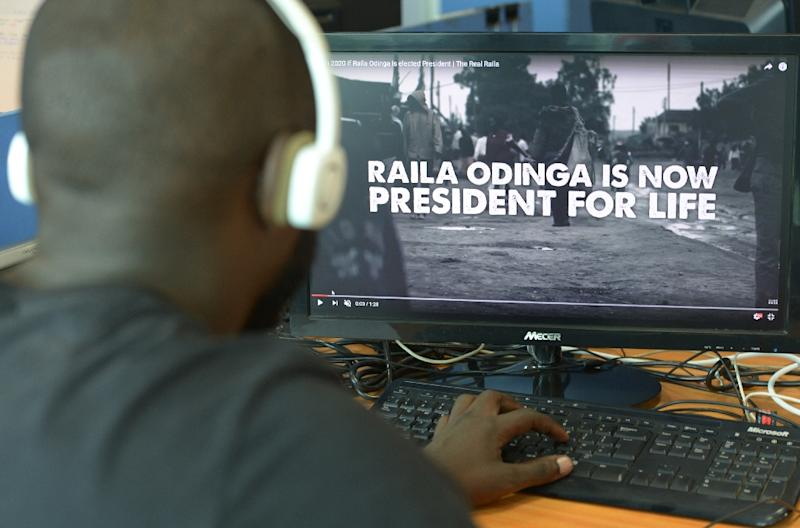 A man watches a hard-hitting online campaign ad just weeks before national elections, in Nairobi on July 13, 2017