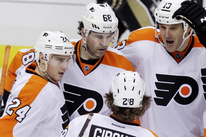 Philadelphia Flyers' Jaromir Jagr (68) celebrates with Matt Read (24), Pavel Kubina (13) and Claude Giroux (28) after scoring in the third period during Game 2 of an opening-round NHL hockey Stanley Cup playoff series against the Pittsburgh Penguins in Pittsburgh Friday, April 13, 2012. The Flyers won 8-5. (AP Photo/Gene J. Puskar)
