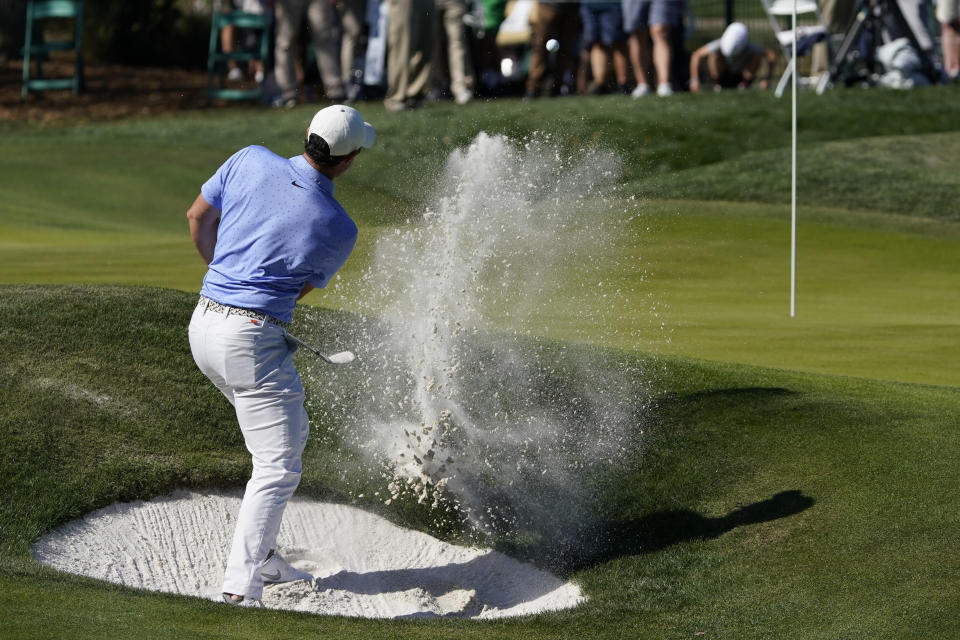 Rory McIlroy, of Northern Ireland, hits from the bunker on the ninth hole during the second round of the The Players Championship golf tournament Friday, March 12, 2021, in Ponte Vedra Beach, Fla. (AP Photo/John Raoux)