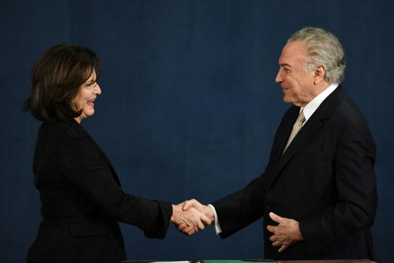 Brazilian President Michel Temer congratulates Raquel Dodge after she was sworn in as Brazil's new attorney general