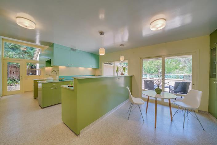 The tri-color kitchen and dining area add a pop of color to the house. (Courtesy Brandon Valente, Brandon V Photography)