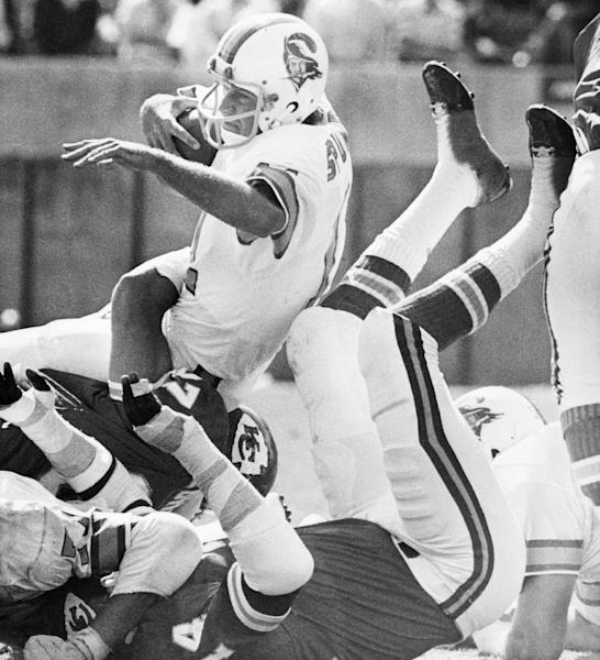 FILE - In this Oct. 31, 1976 file photo, Tampa Bay Buccaneers quarterback Steve Spurrier is brought down in a pile of Kansas City Chiefs during an NFL football game in Tampa, Fla. Bad as the expansion Tampa Bay Buccaneers were in 1976, going 0-14 on the way to what became a 26-game losing streak, they never were as big of an underdog as the Jacksonville Jaguars are against the Denver Broncos this weekend. (AP Photo/File)