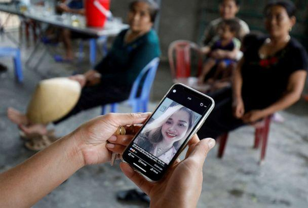 PHOTO: A relative looks at an image of Bui Thi Nhung, 19, who was among the victims found in a lorry in Britain, at her home in Nghe An province, Vietnam, Oct. 26, 2019. (Nguyen Huy Kham/Reuters, FILE)