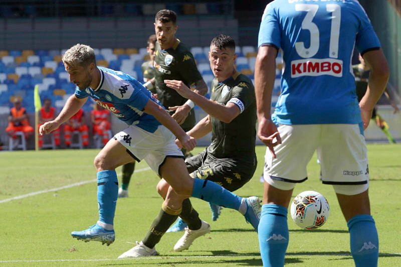 Napoli's Dries Mertens, left, is challenged by Brescia's Daniele Gastaldello during the Serie A soccer match between Napoli and Brescia, at the San Paolo stadium in Naples, Italy, Sunday, Sept. 29, 2019. (Cesare Abbate/ANSA via AP)