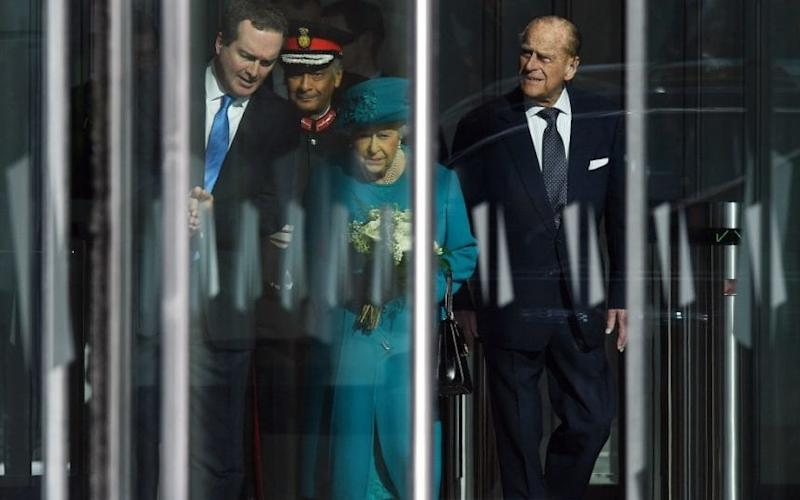 Queen Elizabeth II departs with her husband Prince Philip, the Duke of Edinburgh after officially opening the new Cyber Crime Security centre in London - ANDY RAIN/EPA