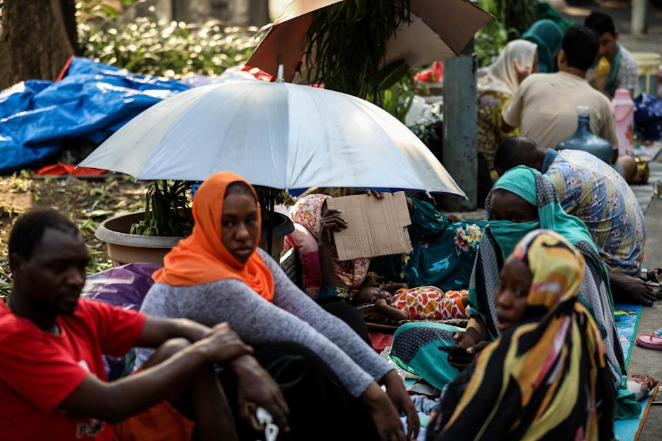 Sudanese refugee families living in tents near Jakarta's UNHCR headquarters to protest their resettlement delays in Jakarta, Indonesia, on July 6, 2019. Indonesia is home to about 14,000 refugees. Afghanistan, Sudan and Somalia are one of the biggest groups of refugees in Indonesia. Afghan Hazaras, who represent a significant number of arrivals to Indonesia, hoping to arrange onward passage to Australia, face many of the same difficulties that other asylum seekers and refugees do. However, they are a particularly vulnerable population given their religious minority status. (Photo by Andrew Gal/NurPhoto via Getty Images)