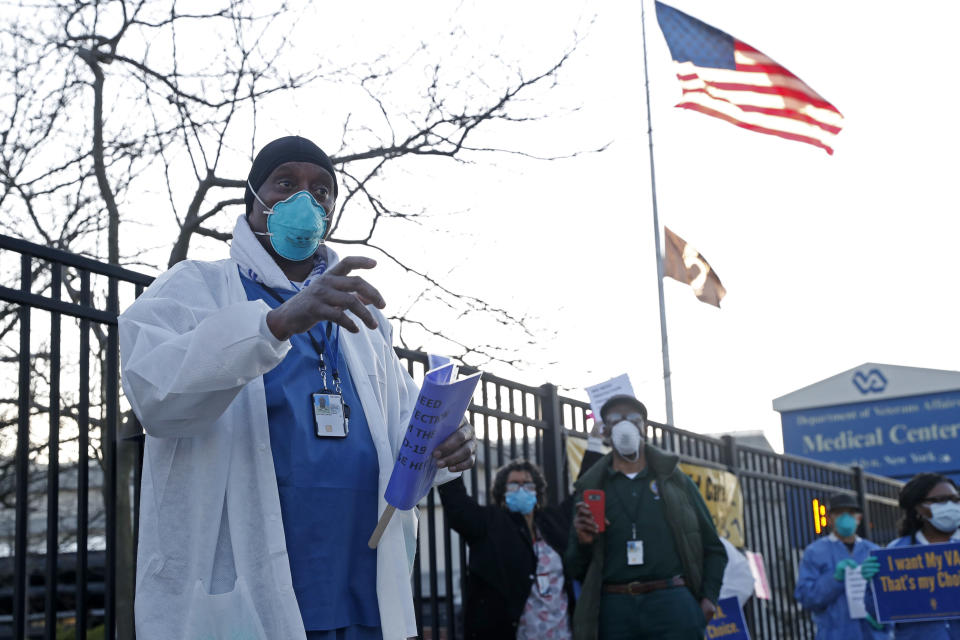 Wayne Malone speaks to the media as he joined registered nurses outside the Brooklyn Veterans Administration Medical Center, Monday, April 6, 2020, in New York, where workers called for more personal protective equipment (PPE) and staffing assistance to care for those affected by the current coronavirus outbreak. (AP Photo/Kathy Willens)