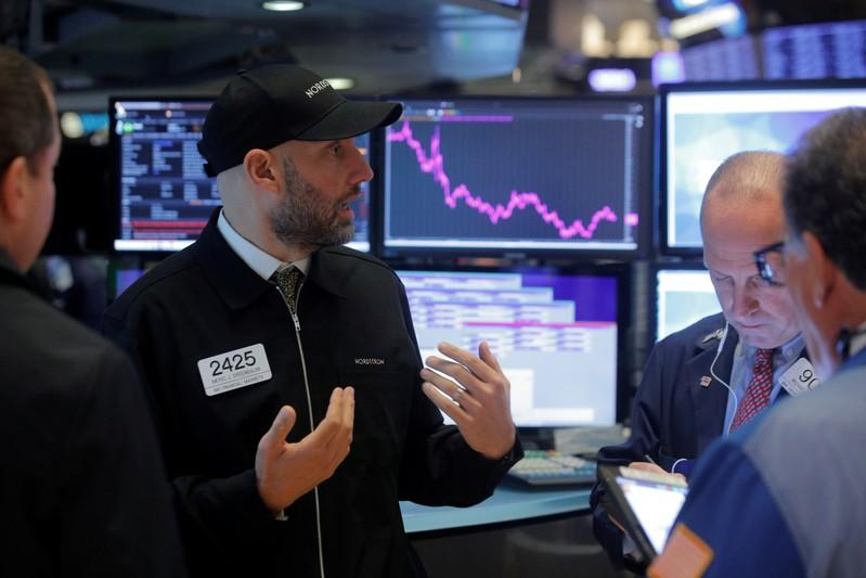 Wall St. dips after S&P notches record, Fed on deck