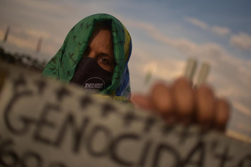 BRASILIA, BRAZIL - JULY 02: A member of the 'Levante de Mulheres' (Women's Uprising) group holds a sign that reads