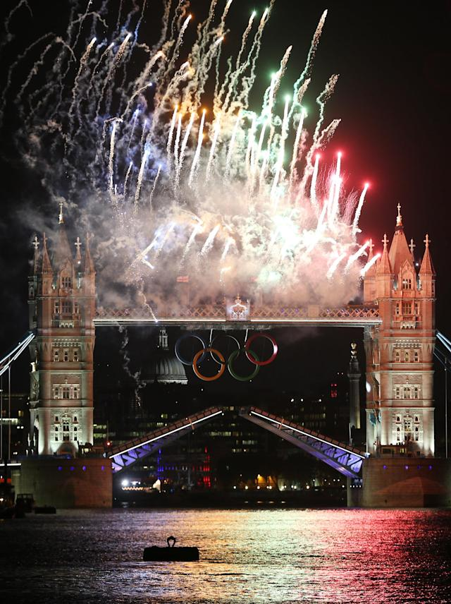 LONDON, ENGLAND - JULY 27: Fireworks light up Tower Bridge as the London 2012 Olympics opening ceremony takes place on July 27, 2012 in London, England. Athletes, heads of state and dignitaries from around the world have gathered in the Olympic Stadium for the opening ceremony of the 30th Olympiad. London plays host to the 2012 Olympic Games which will see 26 sports contested by 10,500 athletes over 17 days of competition. (Photo by Peter Macdiarmid/Getty Images)