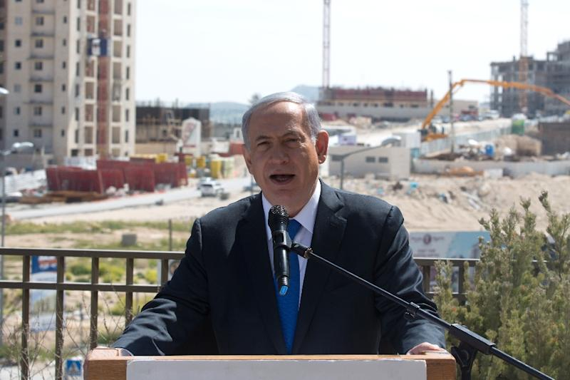 Israeli Prime Minister and Likud party's candidate running for general elections, Benjamin Netanyahu gives a statement to the press during his visit in Har Homa, an Israeli settlement neighbourhood of annexed east Jerusalem, on March 16, 2015 (AFP Photo/Menahem Kahana)