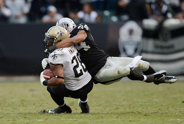OAKLAND, CA - NOVEMBER 18: Mark Ingram #28 of the New Orleans Saints gets tackled around the kneck by Mike Mitchell #34 of the Oakland Raiders during the fouth quarter of an NFL football game at O.co Coliseum on November 18, 2012 in Oakland, California. The Saints won the game 38-17. (Photo by Thearon W. Henderson/Getty Images)