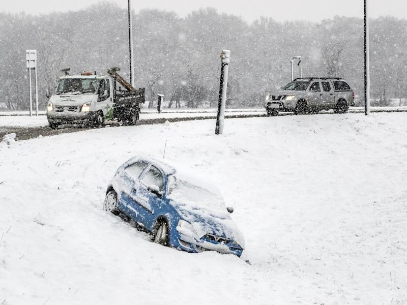 A car that has come off the road in snow in Bedale, North Yorkshire, on February 24, 2010: Danny Lawson/PA Wire