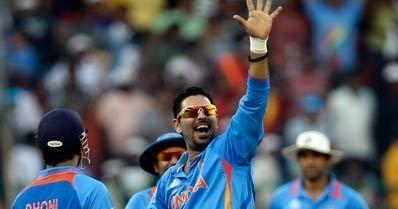 Yuvraj signals to the dressing room after taking a 5-for