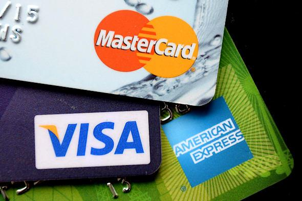 Embargoed to 0001 Saturday March 29File photo dated 03/09/13 of credit cards as one in five consumers are using credit cards to pay household bills, according to a survey. PRESS ASSOCIATION Photo. Issue date: Saturday March 29, 2014. Of the 21% using credit to pay utility bills, 11% or 3.4 million have turned to their card to pay for gas and electricity, with 52% of them blaming recent price hikes, the poll for comparison website TotallyMoney.com found. Some 6.5% pay their council tax on credit cards and 4.3% do the same for their water bills, the poll revealed. With many providers levying charges of around 2% for credit card payments, this could add ?29 to the average annual council tax bill, ?24 to the average annual energy bill and ?8 to water bills, the site said. The survey also found 5% of those renting are paying with credit cards and 4% of homeowners are using their card to pay off their mortgage. See PA story CONSUMER Credit. Photo credit should read: Andrew Matthews/PA Wire